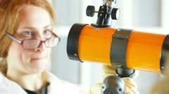looking at telescope scientist female - stock footage