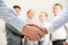 Image of business handshake after making agreement Stock Photos