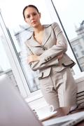 Stock Photo of portrait of a successful businesswoman looking at camera in office