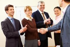 Image of successful handshake after business training Stock Photos