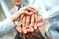 Image of business people hands on top of each other Stock Photos