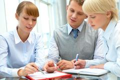 Image of business people consulting during paperwork Stock Photos