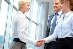 Image of businesswomen handshake after signing new contract Stock Photos