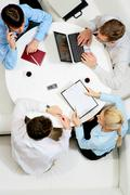 above view of friendly businessteam planning work at meeting - stock photo