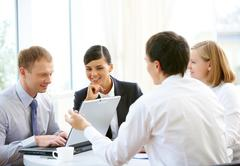 photo of confident employees planning work in office - stock photo