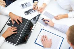 image of business people hands working with papers and typing at meeting - stock photo