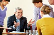 Photo of happy chief explaining work to subordinate persons Stock Photos