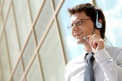 image of friendly telephone operator outside - stock photo