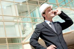 Portrait of confident smiling foreman calling by the phone Stock Photos