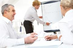 photo of successful manager standing by whiteboard and explaining his ideas - stock photo