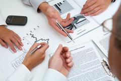 Image of human hands during paperwork Stock Photos