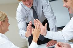 image of business people with their palms opposite each other symbolizing suppor - stock photo
