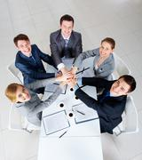 above view of business people with their hands on top of each other looking at c - stock photo