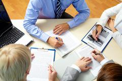 Image of business people working with documents at meeting Stock Photos