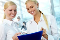 photo of pretty females planning new project in office - stock photo