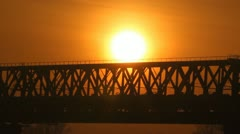 Train on the bridge at sunset. Railroad. Stock Footage
