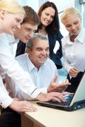 Stock Photo of photo of workteam planning new project in office