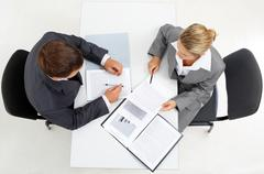 Above view of confident boss with secretary planning their work Stock Photos