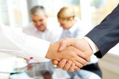 Close-up of business people making agreement in the office Stock Photos