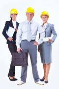 portrait of friendly business team posing in front of camera - stock photo