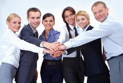 Portrait of friendly business team keeping their hands on top of each other and Stock Photos