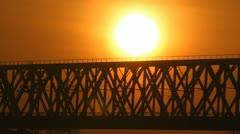 Train on the bridge at sunset. Railroad. - stock footage