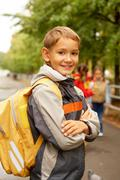 Portrait of happy lad with rucksack on back looking at camera Stock Photos
