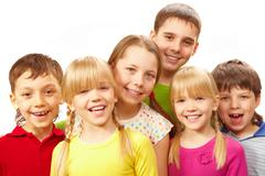 image of young boys and girls smiling at camera - stock photo