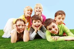 Children on grass Stock Photos