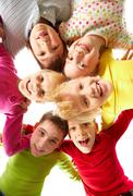 Stock Photo of image of happy kids embracing and laughing in circle