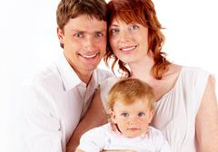 Stock Photo of portrait of joyful family looking at camera over white background