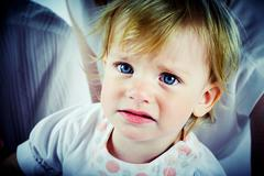 portrait of naughty child looking at camera - stock photo
