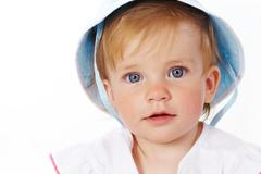 portrait of cute child looking at camera over white background - stock photo
