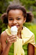 portrait of pretty girl eating ice-cream - stock photo
