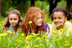 Portrait of friendly girls relaxing in park on summer day Stock Photos