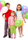 portrait of kids with colorful balloons at birthday party - stock photo