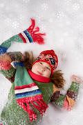 Above view of cheerful girl having fun in snow Stock Photos