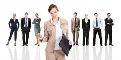 Row of several business people in different poses with pretty leader in front Stock Photos