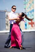 Portrait of attractive couple dancing together outdoor Stock Photos