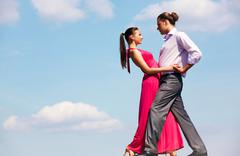 Portrait of passionate couple dancing in open air Stock Photos