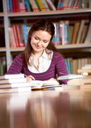 Girl in library - stock photo