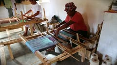 Young Woman Weaves in Madagascar. Stock Footage