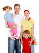 Portrait of a happy smiling family Stock Photos