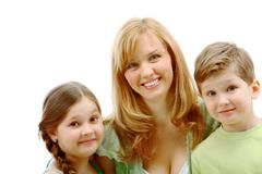 portrait of mother and her children near by looking at camera - stock photo