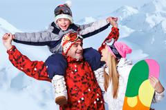 Portrait of happy family with snowboards having fun on winter resort Stock Photos