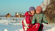 Stock Video Footage of Portrait of a young mother with a baby in the winter