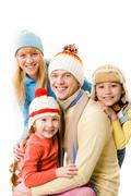 Stock Photo of happy family looking at camera with smiles