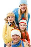 happy family looking at camera and smiling - stock photo