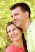 Portrait of cheerful couple on summer vacation Stock Photos