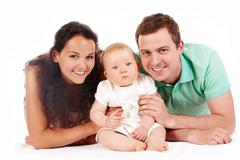 portrait of joyful family looking at camera over white background - stock photo